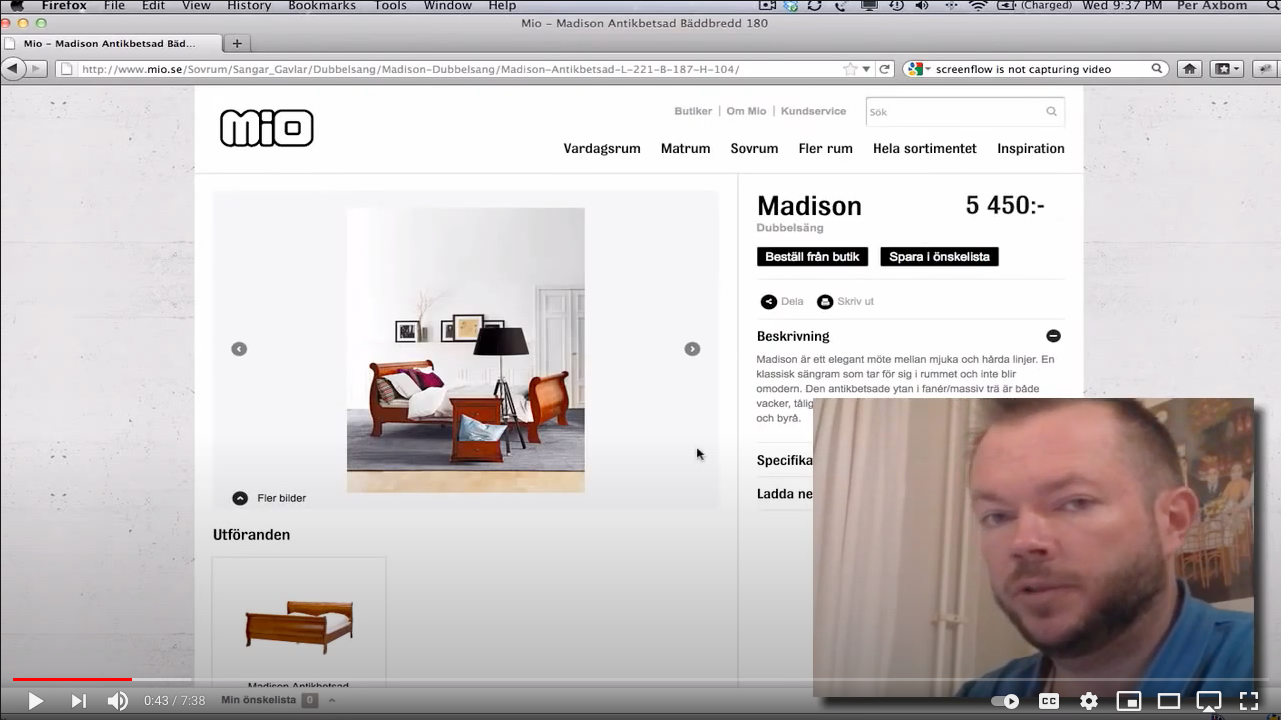 Screenshot from video with Per looking at camera and the Mio website in the background
